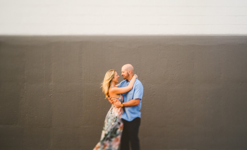 038 - freelens of couple dancing in front of grey and white wall.jpg