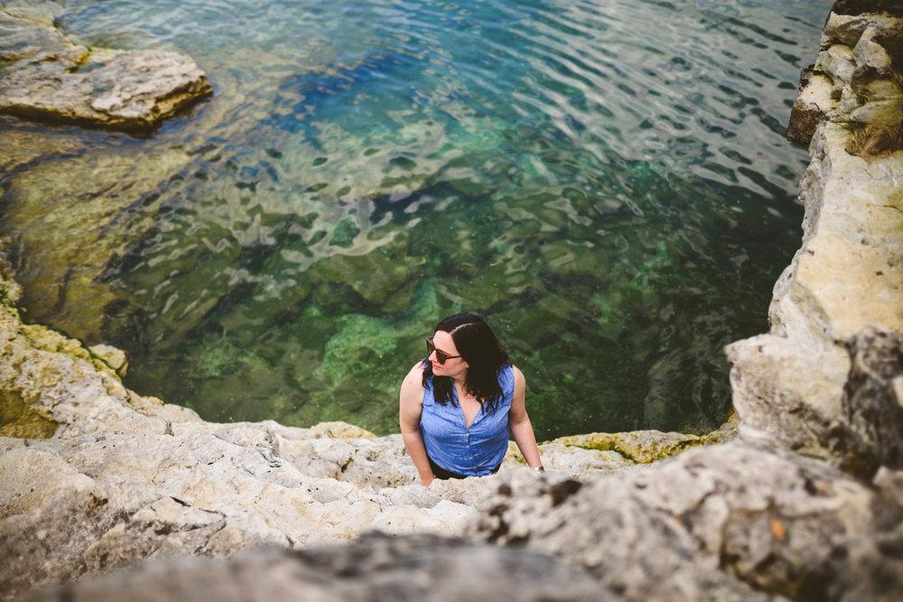 045 - beautiful woman near rocks at a clear lake.jpg