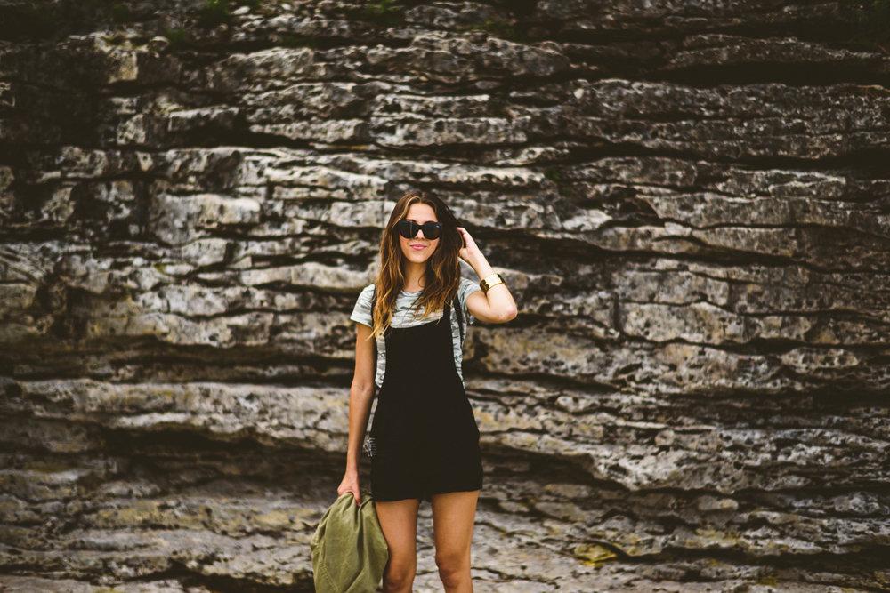 046 - sunglasses girl in front of rocks.jpg