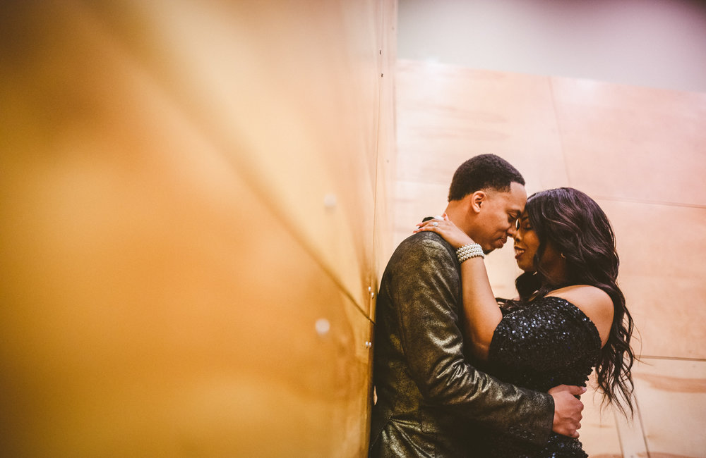 056 - couple share intimate moment in wood lined recording studio.jpg