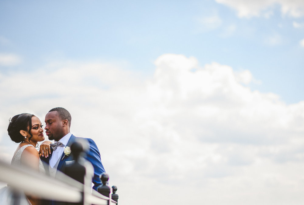 072 - african american couple portrait against gorgeous blue sky and clouds.jpg
