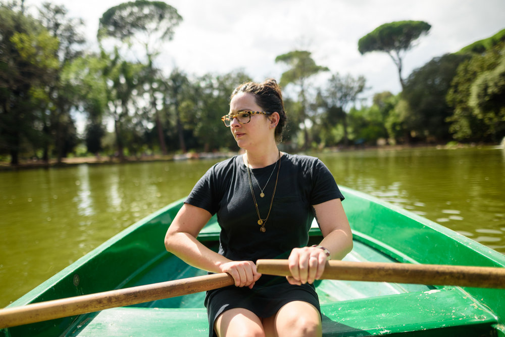 079 - beautiful girl rowing boat on small italian lake.jpg
