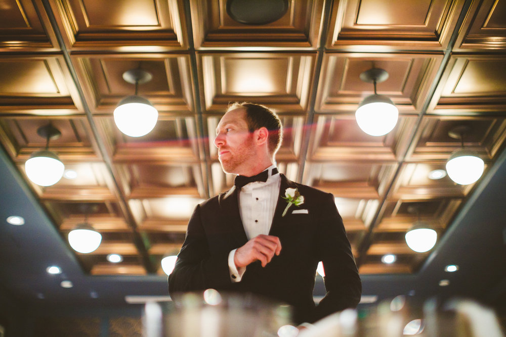 089 - groom gets ready for first look.jpg
