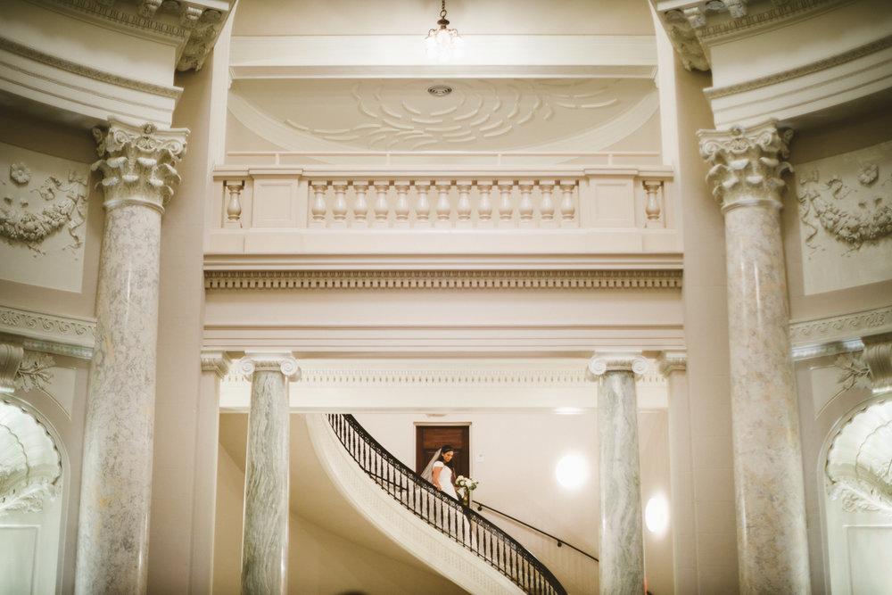 091 - bride descending beautiful staircase for her wedding.jpg