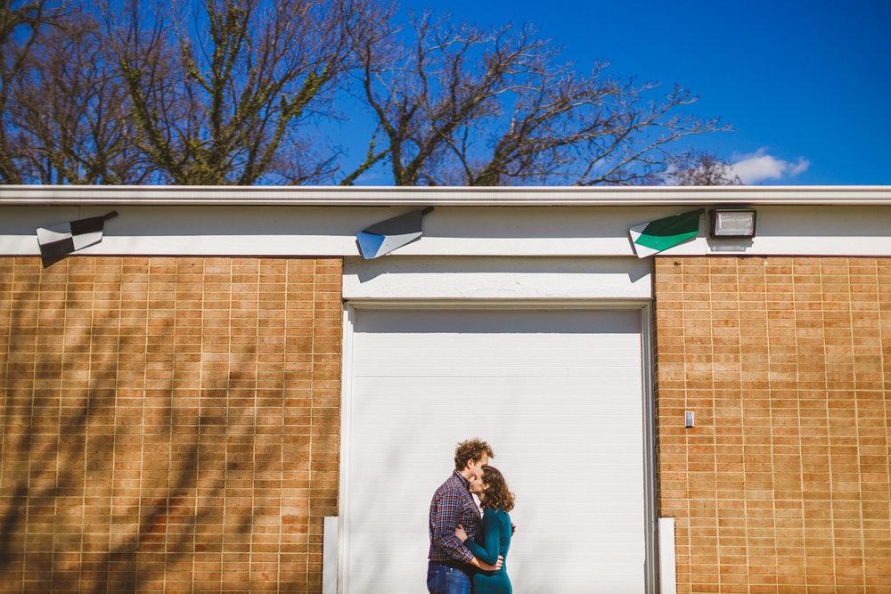 009 - couple in front of white garage door.jpg