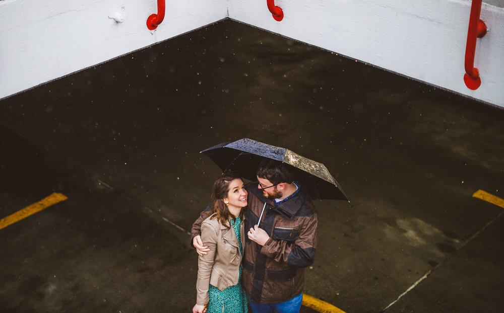 006 - girl looks up at rain with man umbrella.jpg