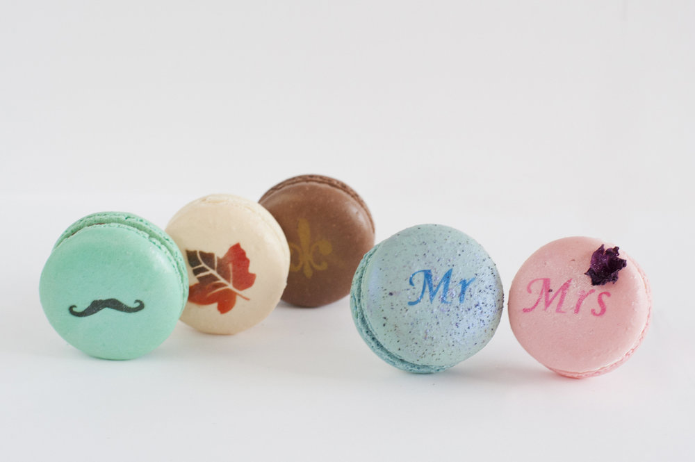 Logos, monograms, & other images can be airbrushed on to macarons