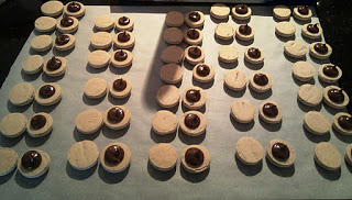 Matched up macarons filled with Nutella