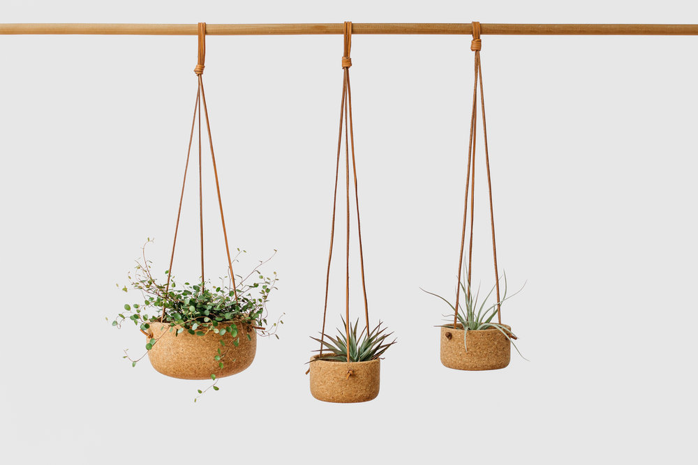 Cork Hanging Planters   are for those city-dwelling friends that have run out of space in their small home! Easily hang these pieces from the ceiling to enjoy a little greenery at home. Bonus: Let them know you can use it as a fruit basket as well!  $74- $110