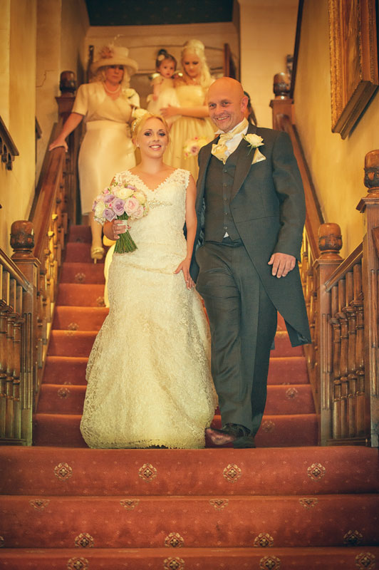 Cardiff Wedding Photographers at Miskin manor Bride descending stairs