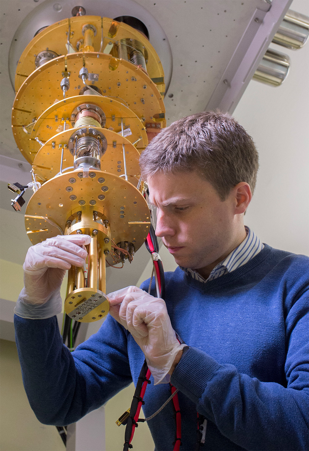 Keeping cool: Edward Laid adjusting the cryogenic core which chills nanotube devices to an operating temperature near absolute-zero, using a Triton from Oxford Instruments.