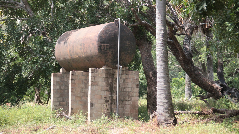 There are several water storage tanks on-campus.  With the addition of an electrical pumping system, water should be plentiful, even in the dry season.