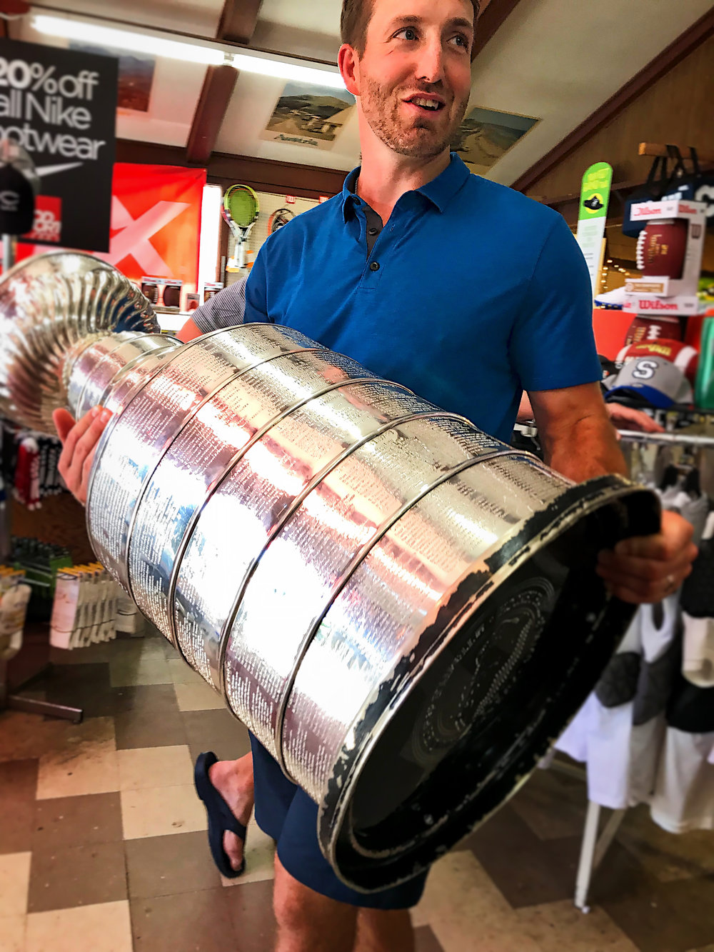 Brooks Orpik, defenseman (#44) for the world champion Washington Capitals delivers the Stanley Cup to Cohasset's GOOD SPORT.