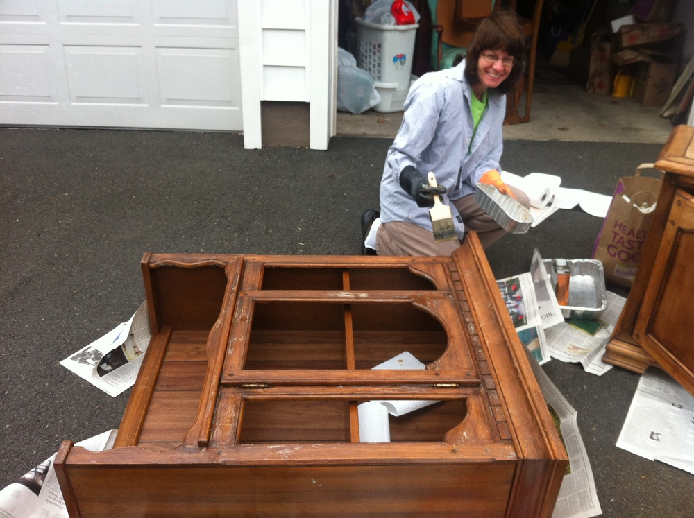 Stripping furniture outside at home workshop.