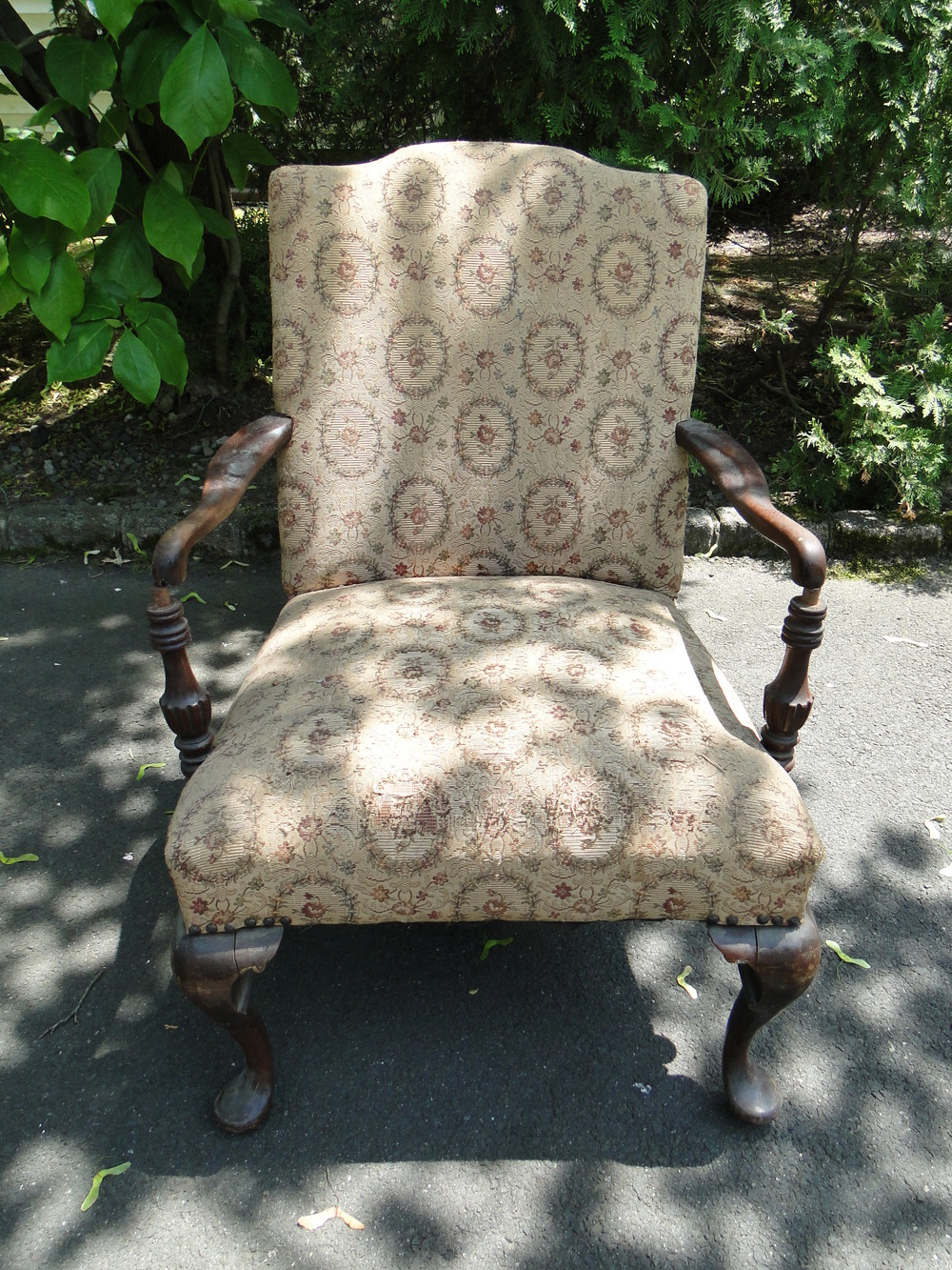 """Before"" view damaged frame, fabric and upholstery"
