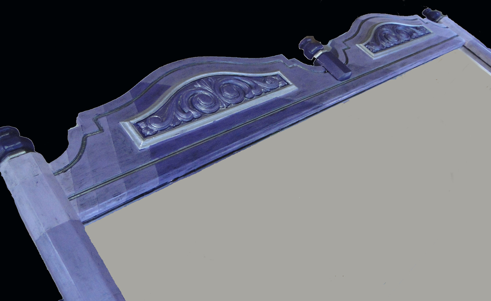 Close up of mirror frame top
