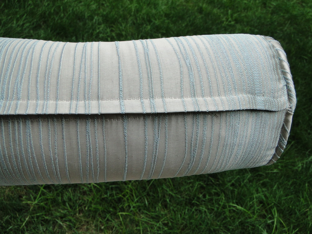 Detail of zipper flap on pillow