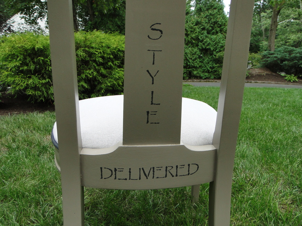 Name of new business stenciled on back of chair