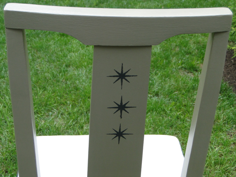 "Stenciled ""stars"" on back of chair"
