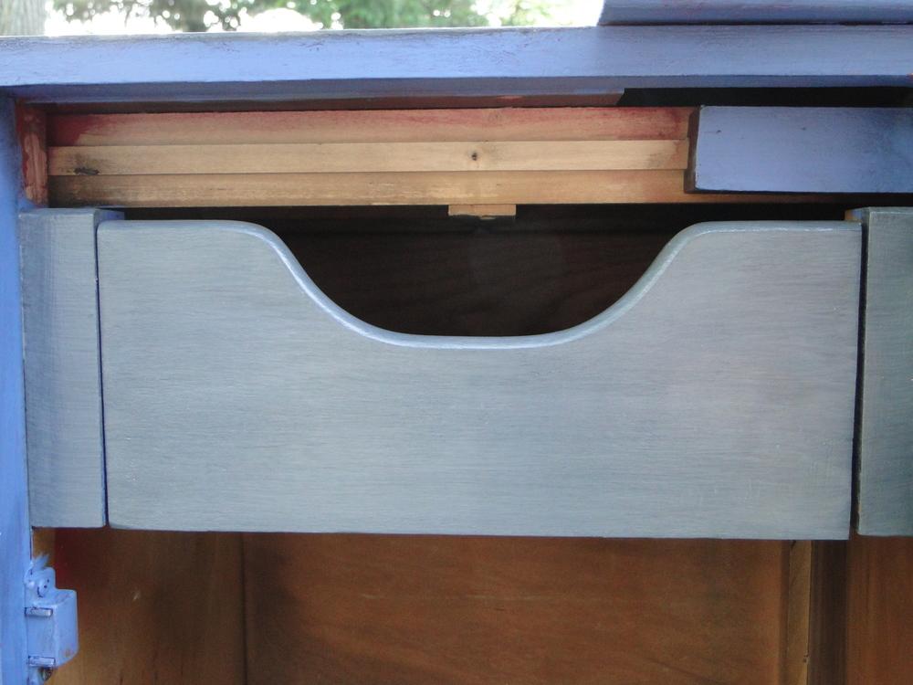 """Subtle """"tone-on-tone"""" grey finish on drawer"""