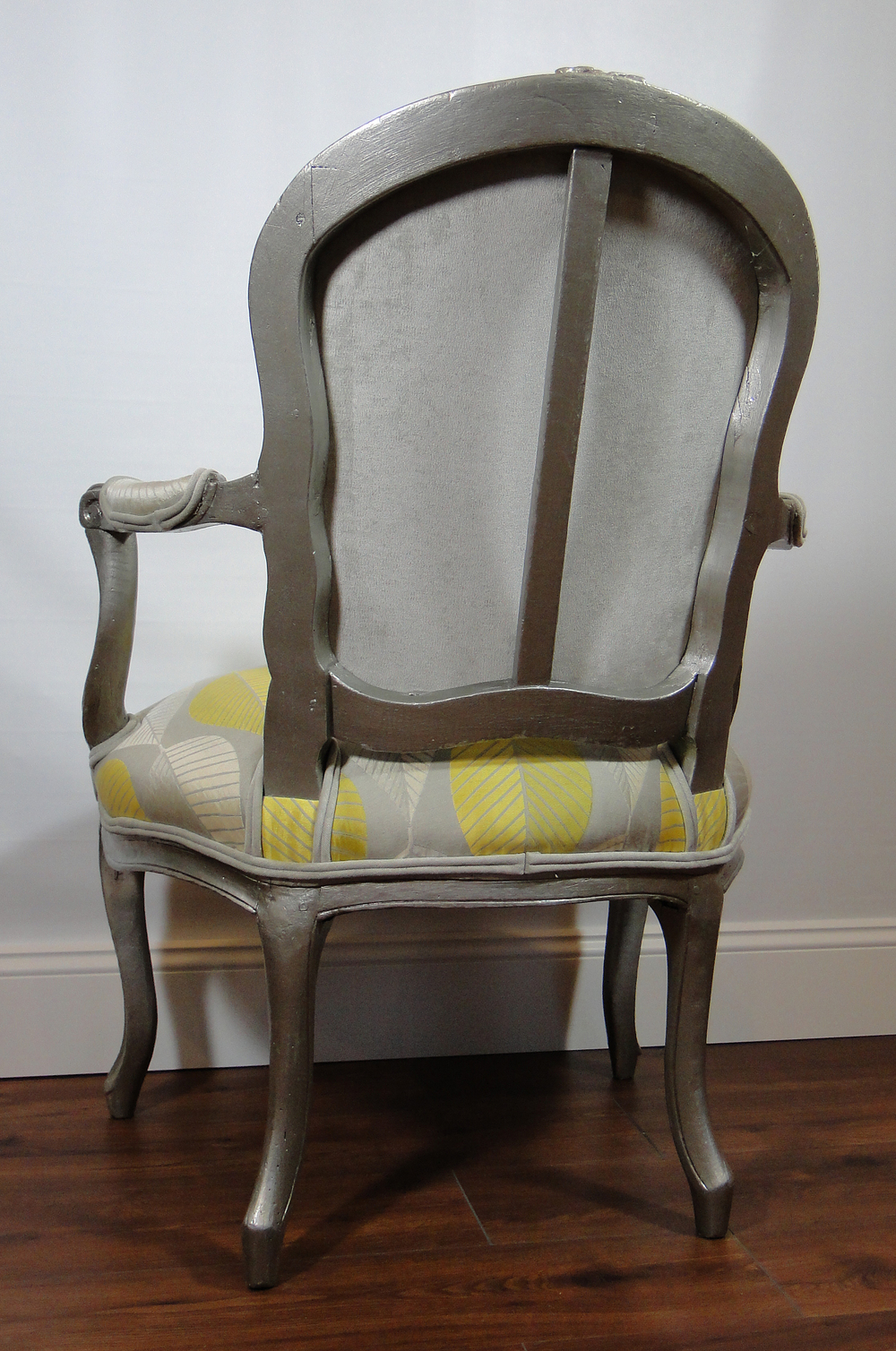 """After"" view of chair rear with contrasting fabric"