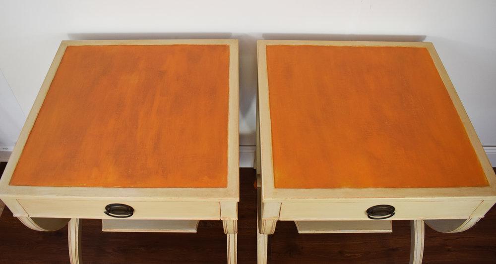 Custom orange paint finish on tops of side tables