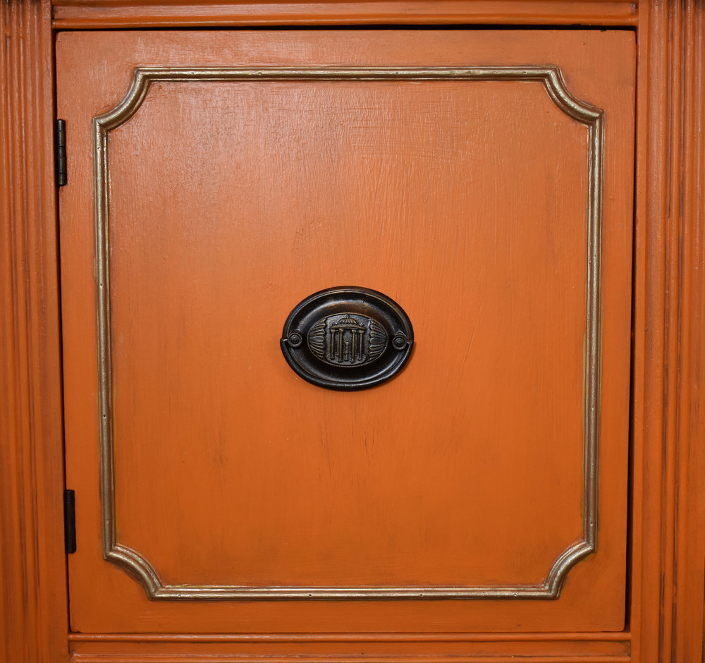 Door close up ... custom orange finish with brown glaze and pale gold molding, plus repainted handles