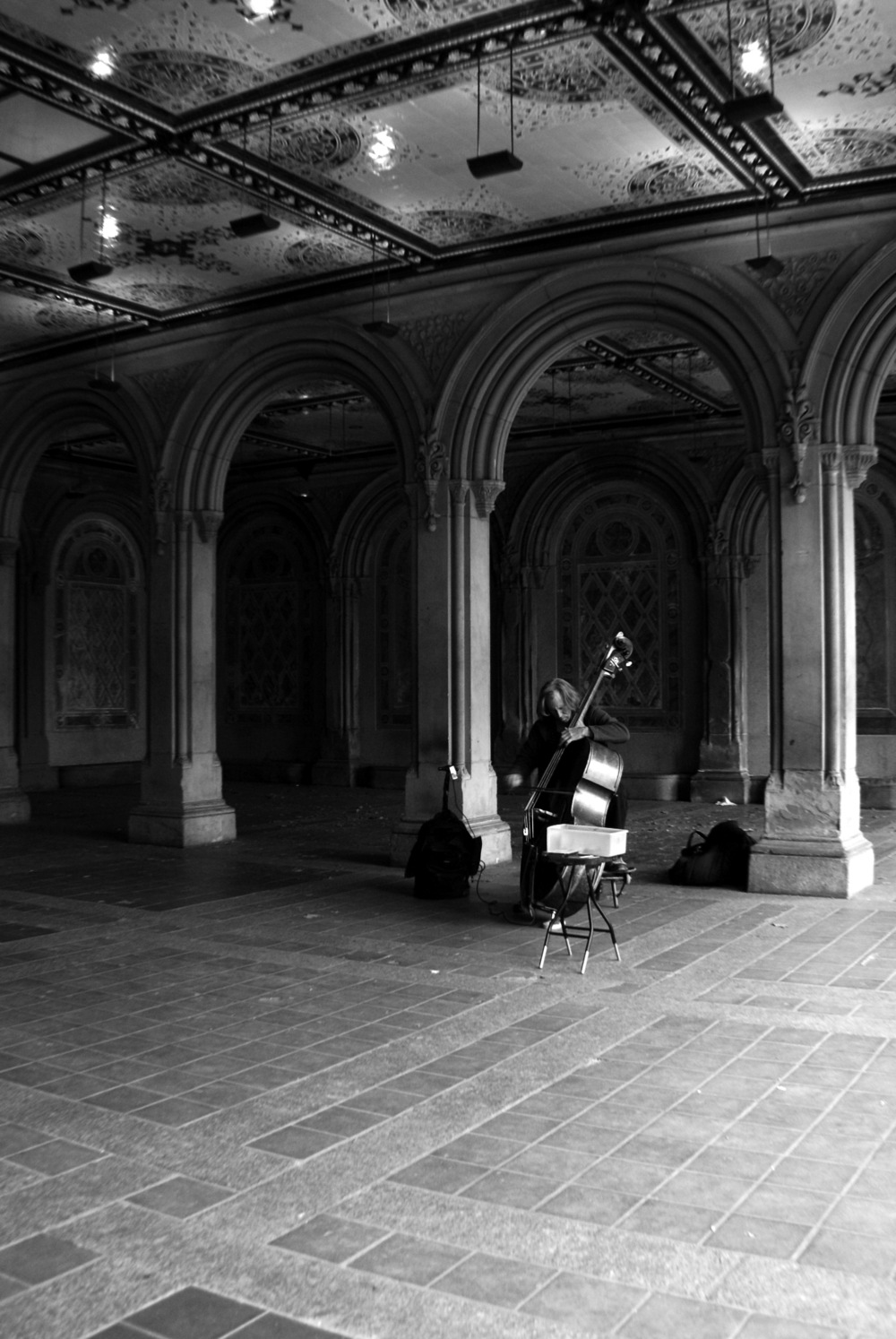 My second day in NYC visiting my friend Helen. We were wandering around Central Park when we came across the cellist playing. His music was soft and slow, echoing in the building. This was one of the things that made me love Central Park.   2/5 - 2014