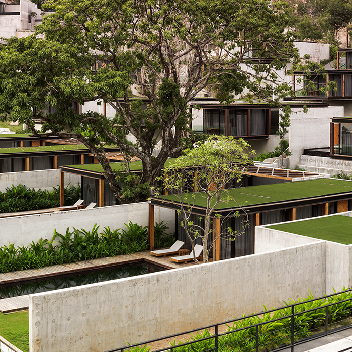 Tropical boxes phase ii of the naka phuket knstrct for Tropical hotel decor