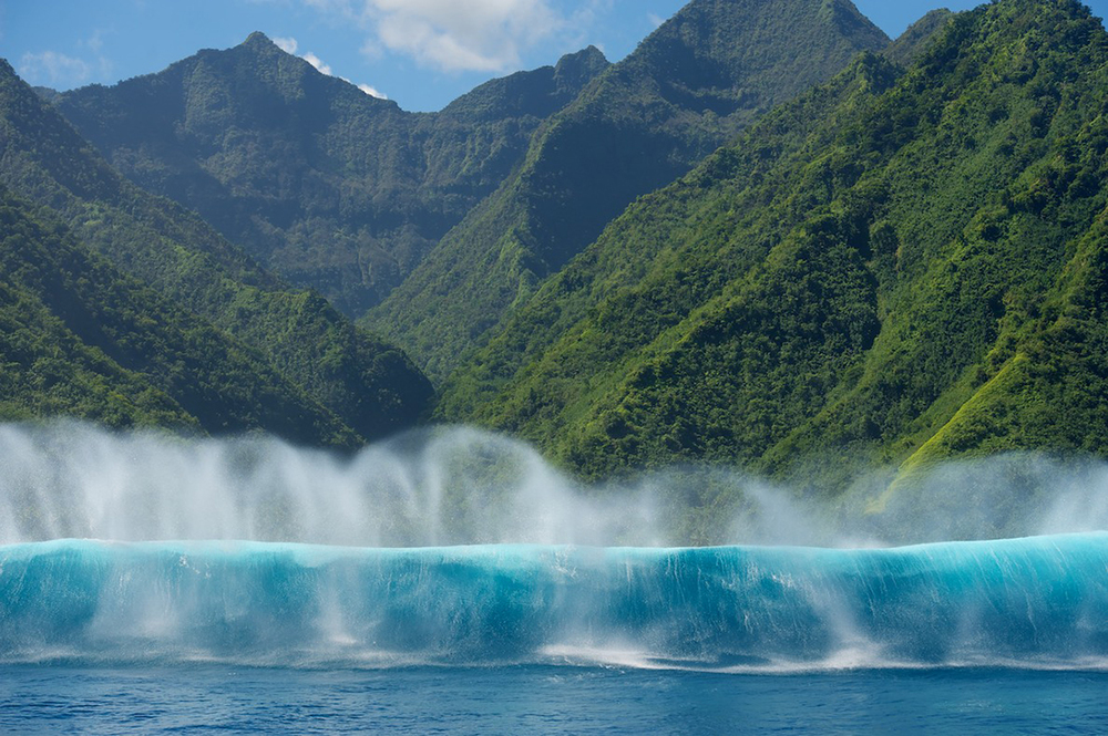 Surfing superwaves of Teahupo'o in Tahiti.