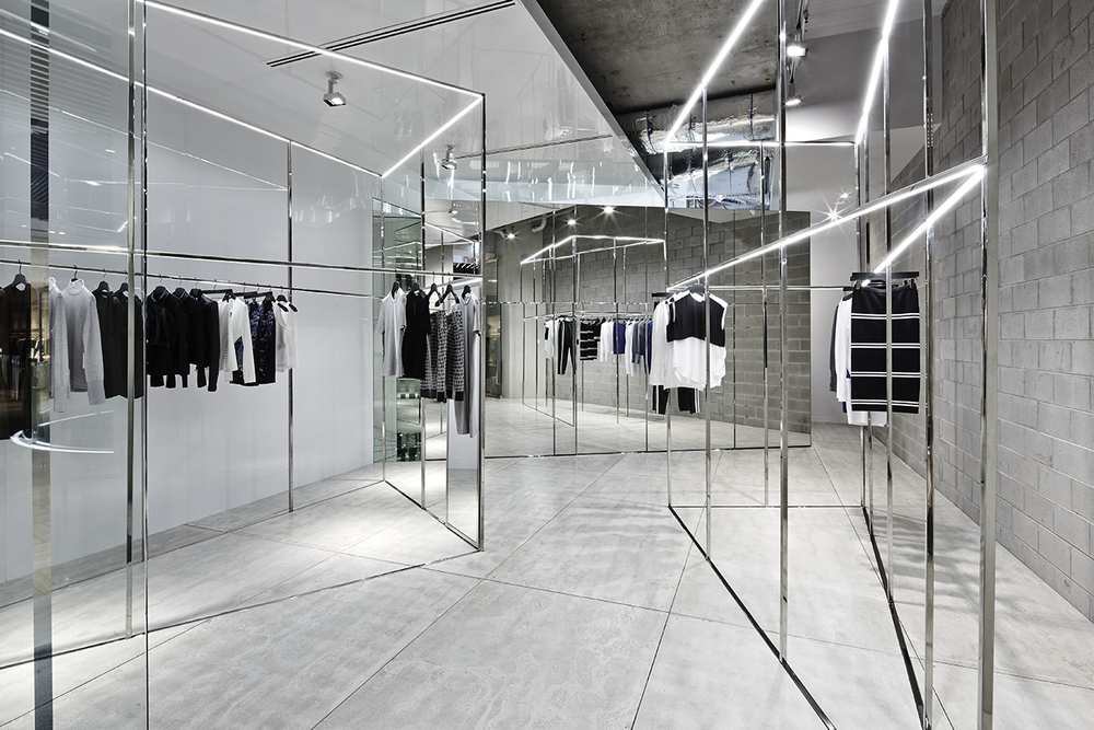 Raw functionality akin creative designs dion lee 39 s first melbourne boutique knstrct for Fashion retail interior design