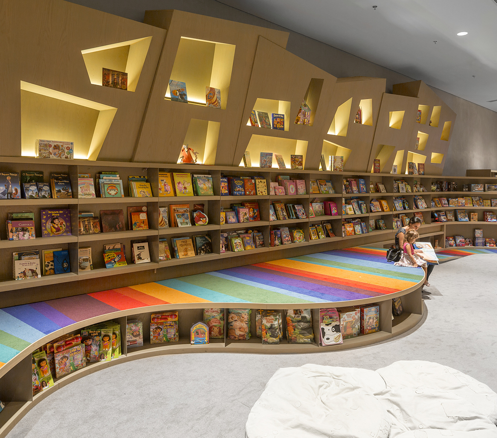 Arthur Casas Designs A Rainbow Twisted Kids Book Den for Saraiva