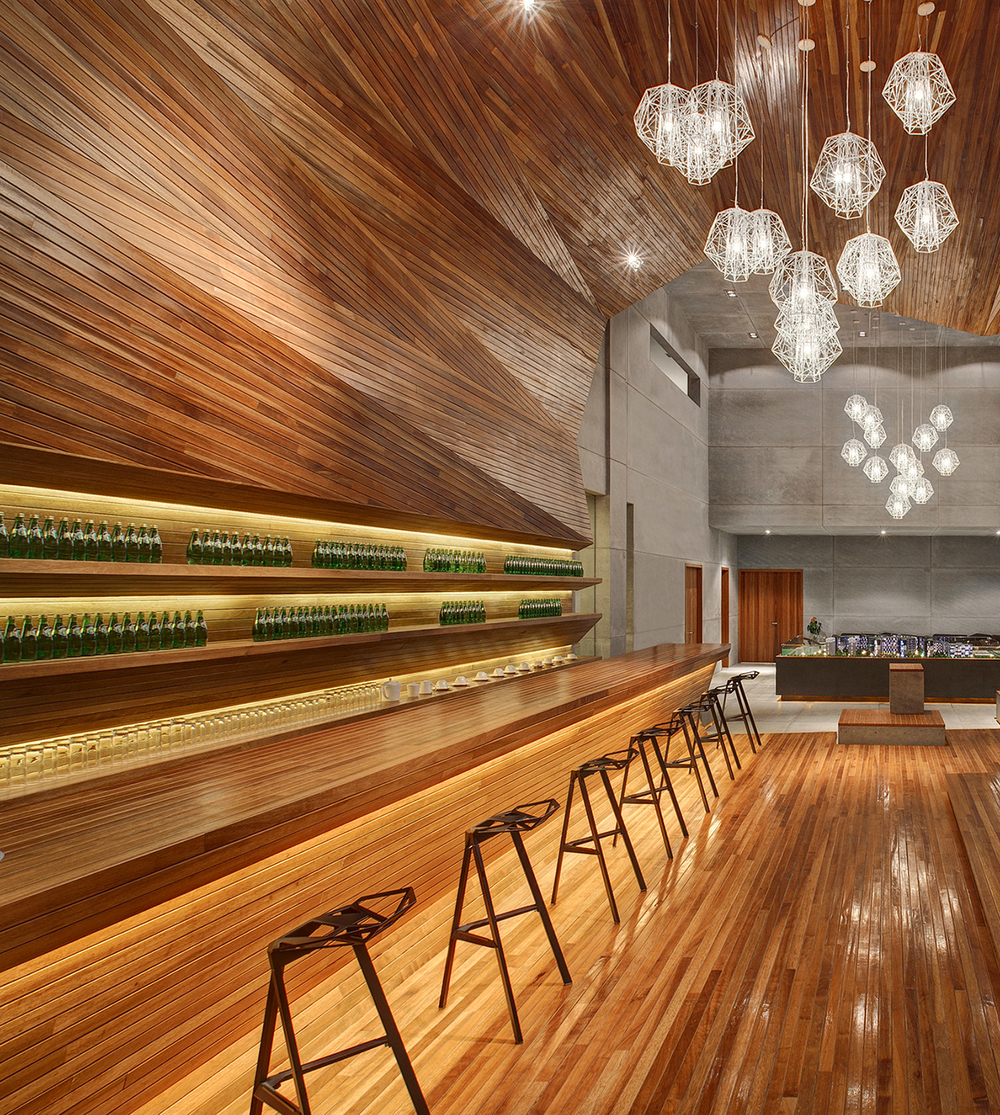 Lumber lusting after hours warm up in wood covered bars for Wooden bar design