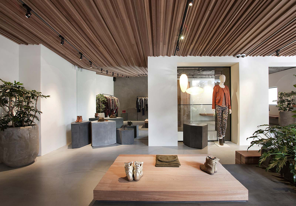 Seoul store || Design: Cigue || Materials: concrete, plaster, sapele wood, steel, and granite || Plants: Ficus umbellata, Monstera, Artcarpus altilis