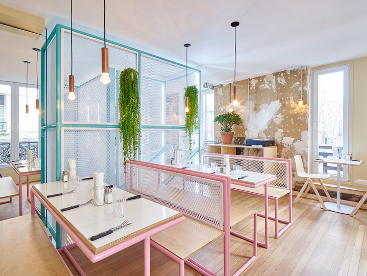 pink and blue pipes with white fencing at pnys new restaurant designed by cut architectures