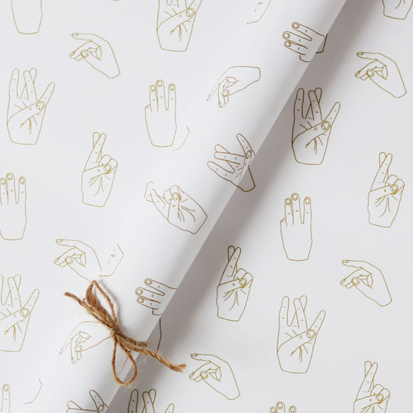 Five hands wrapping paper