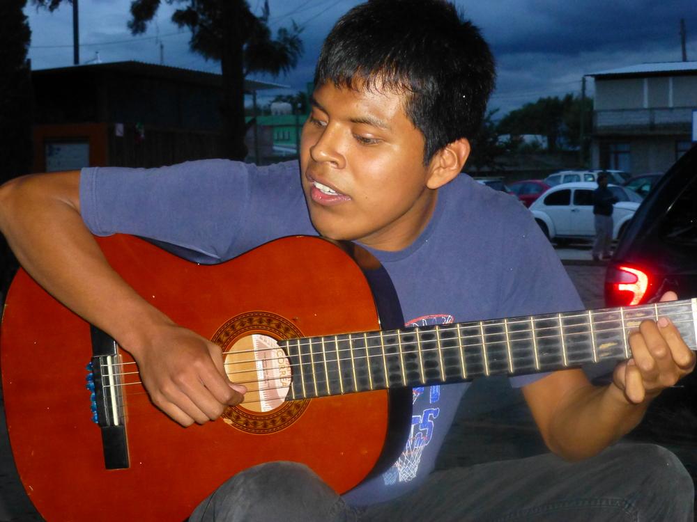 Nacho playing his guitar.