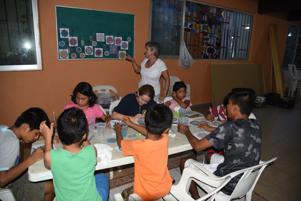 Dorie teaching watercolors to the children.