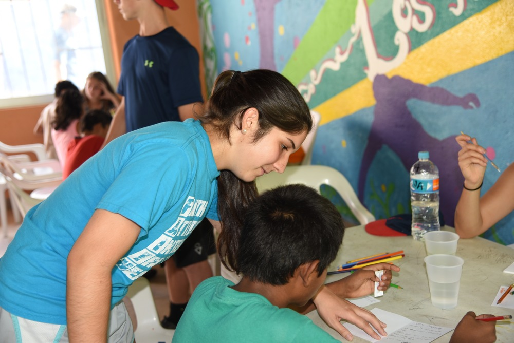 Erin working hard to help Kevin write his thank you note. Her Spanish has come in handy on this trip!