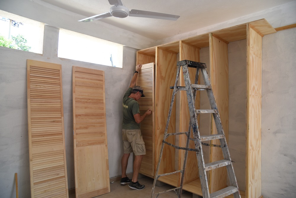 Brian working on the new closets.