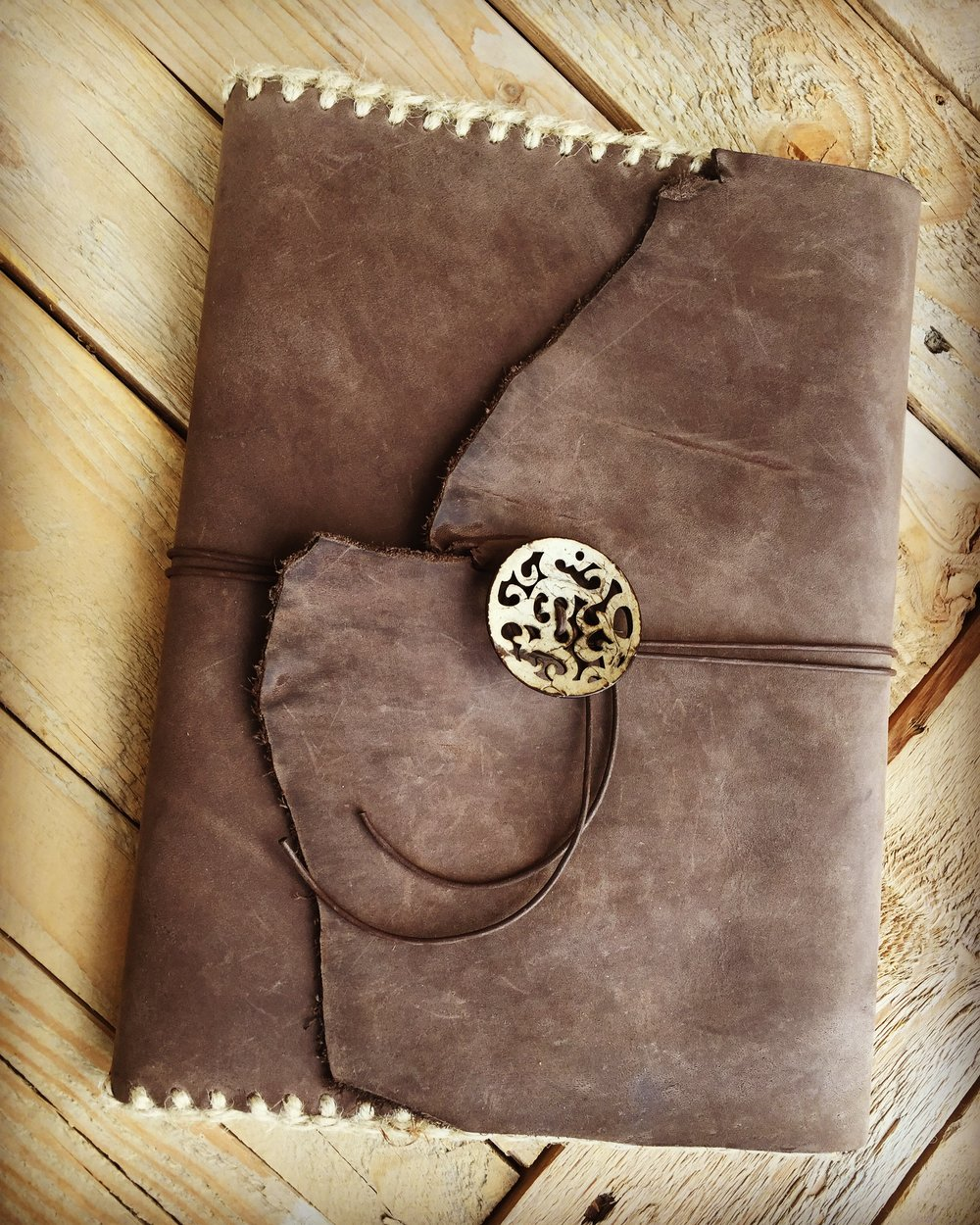 FOR SALE - Handmade Leather Notebook Cover  (above) Re-fillable!  Standard 'composition notebook' included. Carved coconut shell pendant.  $85  ( $14  shipping within the US & sales tax applies to UT residence). Custom Heat Engraving can be added! Email me at:  CircleM@outlook.com