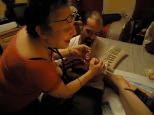 Marcy administering APGAR test on Haydée moments after birth, with Alex, Luis and Nico
