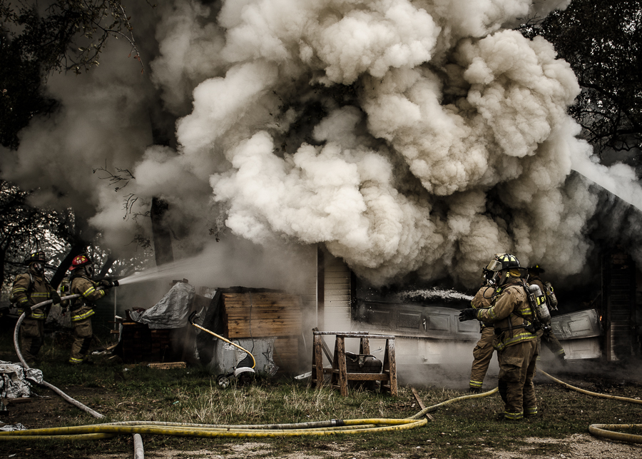 Tolar and Granbury Texas firefighters battle a garage fire near Tolar, TX