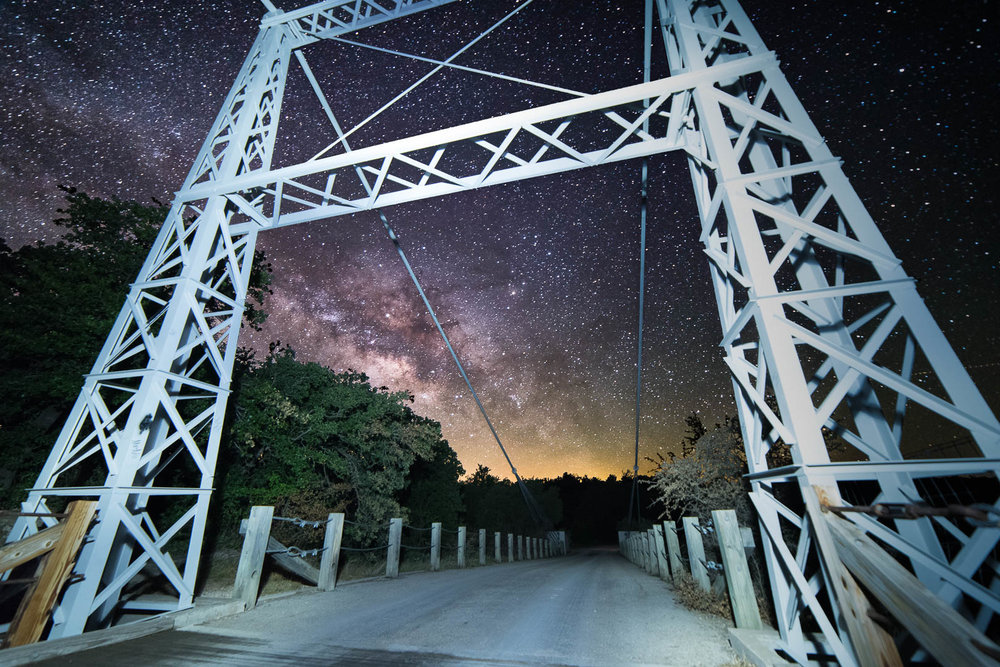 Milky Way above the south end of the Regency Suspension Bridge near Mulllin, Texas  2 frames Nikon D750 Rokinon 14mm 3200 ISO F2.8 30 seconds  Foreground lit with small LED headlamp