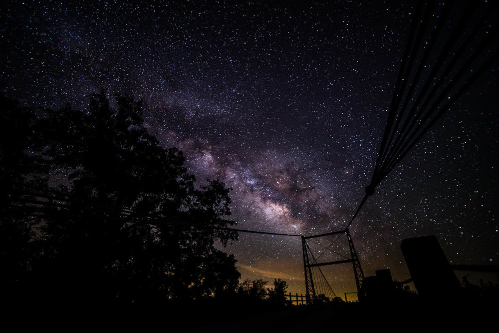 Milky Way over the Regency Suspension Bridge near Mullin Texas in the early morning of 04/27/2017  1 frames Nikon D750 Rokinon 14mm 3200 ISO F2.8 20 second