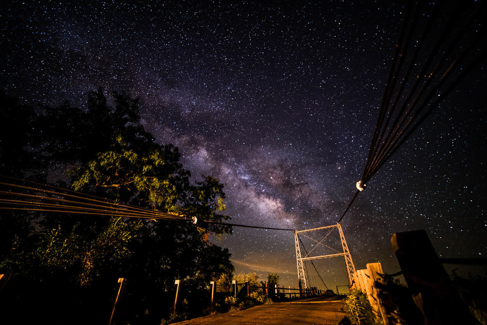 Milky Way over the Regency Suspension Bridge near Mullin Texas in the early morning of 04/27/2017  2 frames Nikon D750 Rokinon 14mm 3200 ISO F2.8 20 seconds  Foreground lit from 100' away with wth the bed light of my truck.