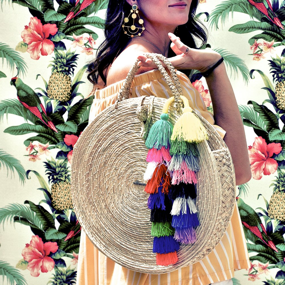 Redefine tropical glam and complement seaside stripes with all these tassels from Fl4mingo