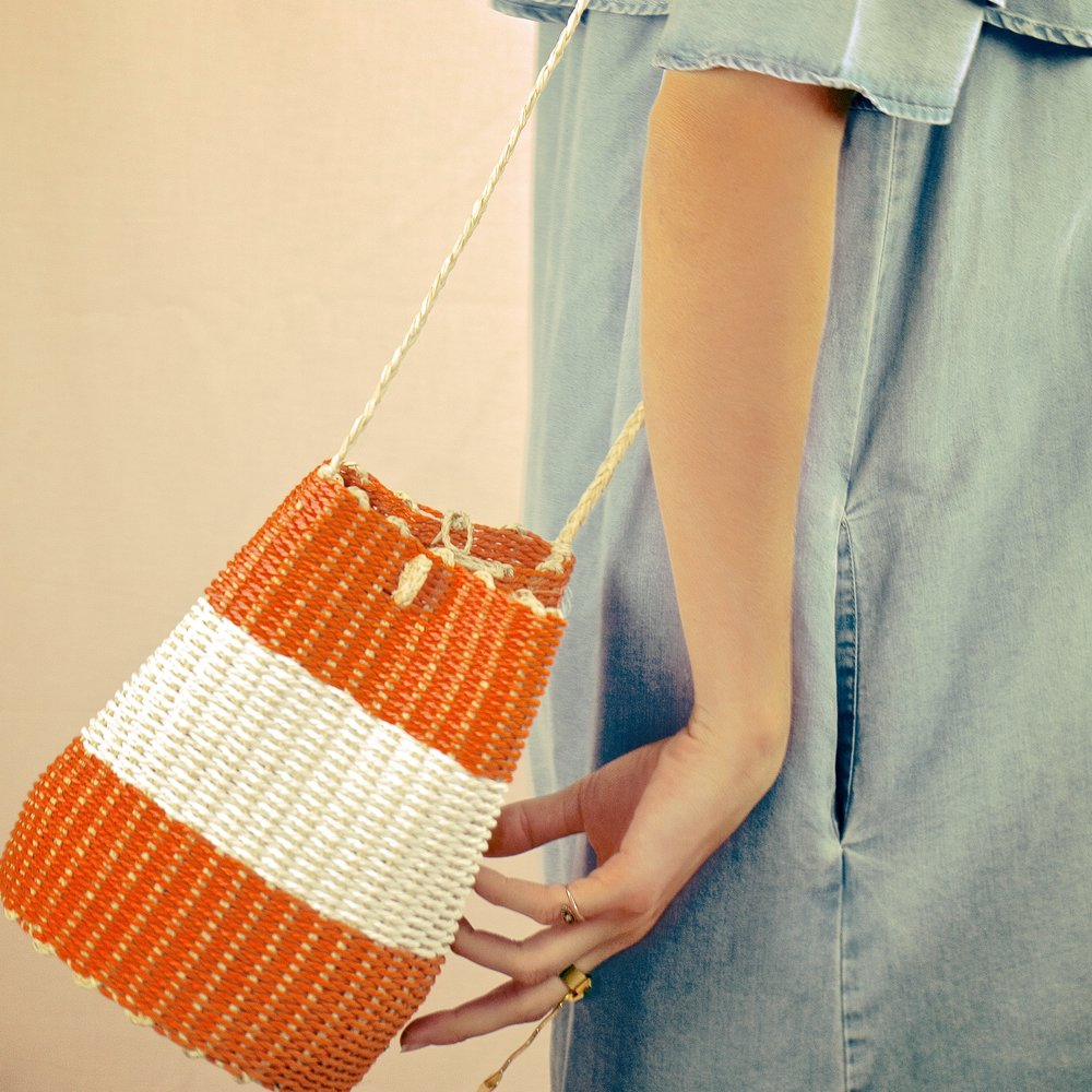 Featuring sweet color-pop bucket bags