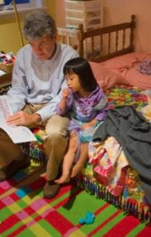 reading to asian girl.jpg