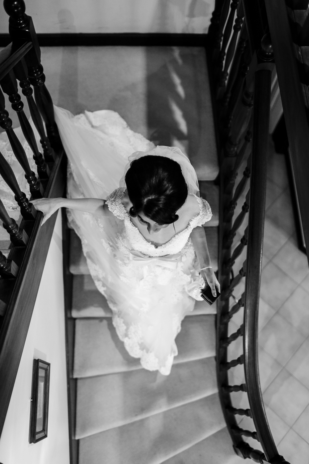 bride walks down stairs